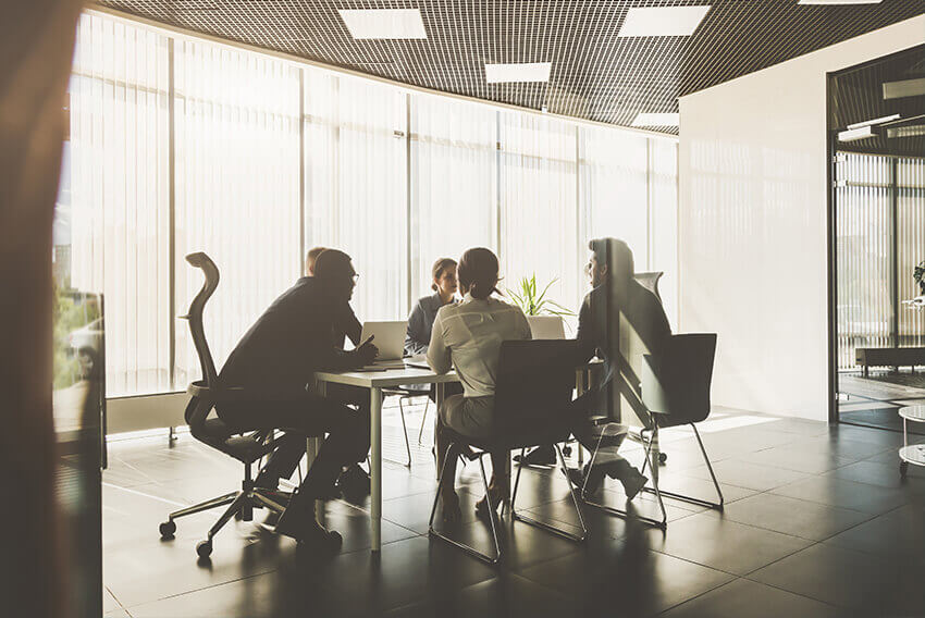 Five employers sitting around a table in a conference room.  Aston Carter Recruitment Articles.