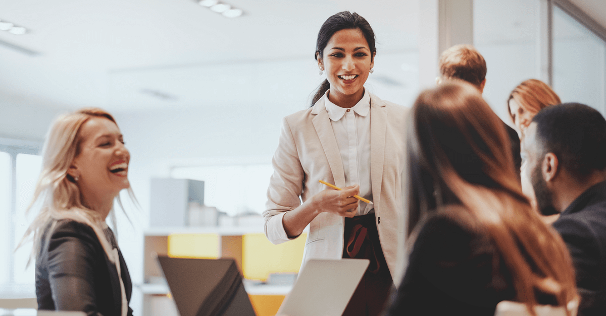 woman smiling at her colleagues in office